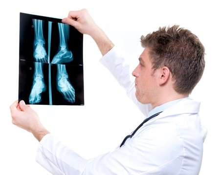 podiatrist: attractive and expressive doctor holding an foot x-ray