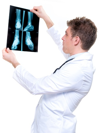 attractive and expressive doctor holding an foot x-ray