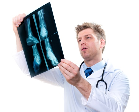 handsome male doctor examining feet x-ray photo