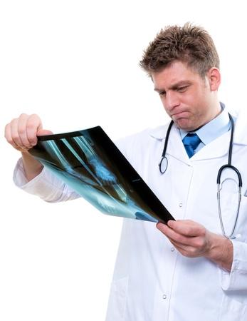 attractive male doctor examining  x-ray photo