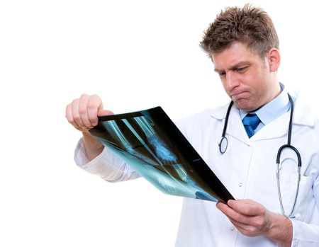 attractive male doctor examining  x-ray Stock Photo - 17795061