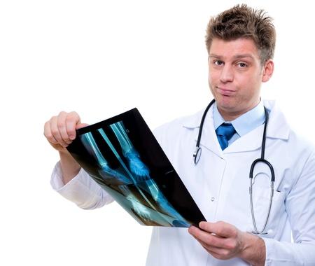 expressive doctor examining bad news x-ray Stock Photo - 17795074