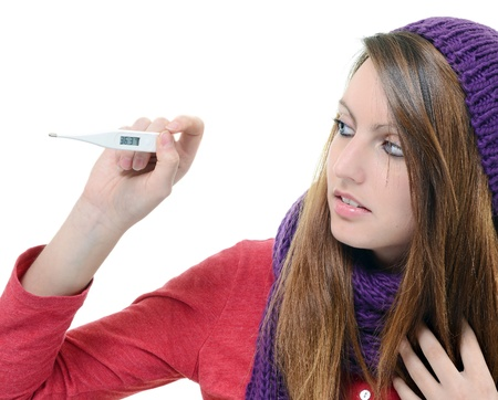 Cute young woman monitor her temperature with thermometer Stock Photo - 17795239