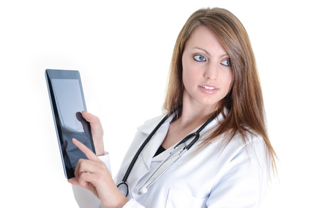 Pretty female student doctor working with an digital tablet photo