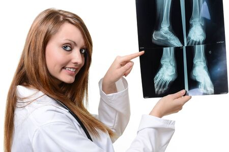 female doctor with x-ray in hand over a white background photo