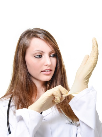 ah1n1: Pretty female doctor is putting protective glove