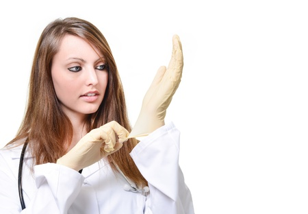 Pretty female doctor is putting protective glove photo