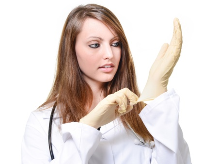 Pretty female doctor is putting protective glove Stock Photo - 17795485