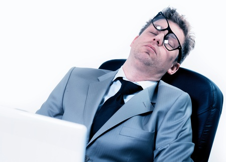 freak out: tired funny portrait of businessman sleeping at the office