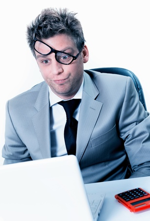 freak out: burning out of handsome manager at the office Stock Photo