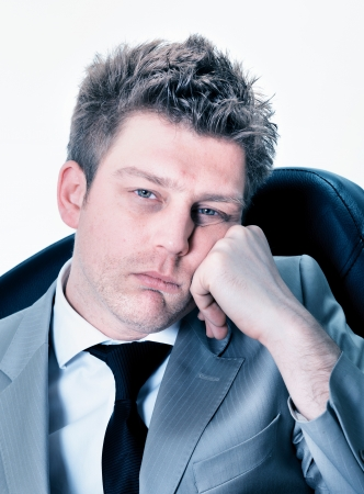 exerted: Portrait of  tired businessman at the office Stock Photo