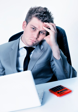 exerted: tired businessman at the office Stock Photo