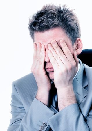 exerted: attractive overwhelmed businessman at the office Stock Photo