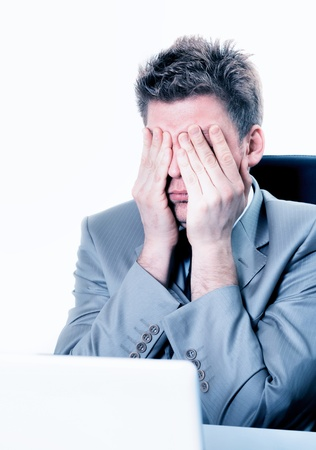 constraints: attractive overwhelmed businessman at the office Stock Photo