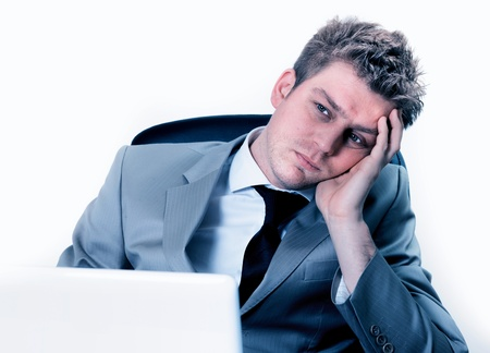 exerted: breakdown of businessman at the office Stock Photo