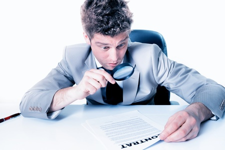 portrait of a handsome young man looking at a contract Stock Photo - 17796004