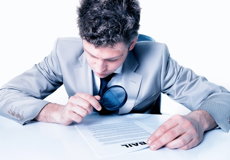 handsome Businessman with magnifying glass analyze contract Stock Photo - 17796060