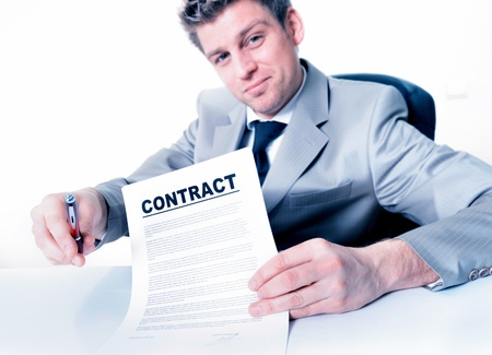 businessman invites to sign a business contract photo