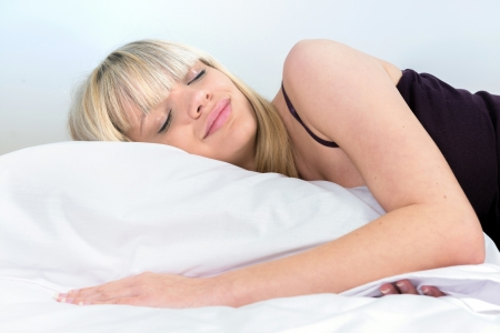 only 1 girl: Portrait of a cute girl sleeping on a pillow Stock Photo