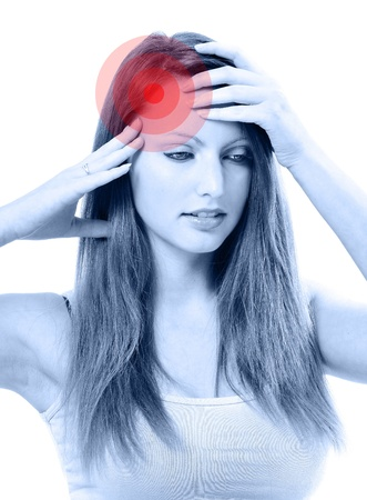 Young unhappy woman with severe headache holding forehead in pain photo