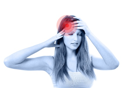 Young unhappy woman with severe headache holding forehead in pain