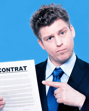 expressive businessman pointing to a contract photo