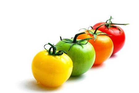 close-up de alinhamento de tomates multicoloridas Imagens
