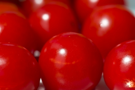 close up cluster of red cherry tomatoes photo