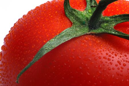 close up of part red tomato photo