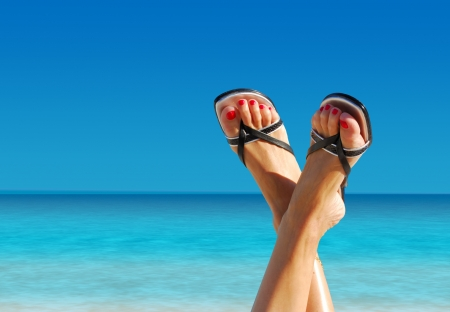 well being: nice feet crossed on an island paradise