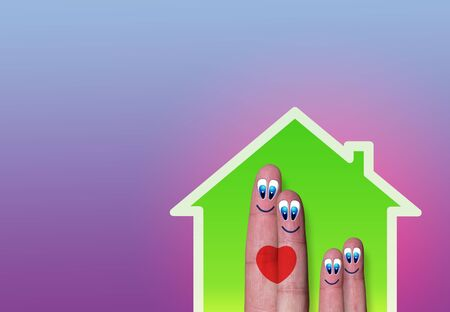 beetwen: low-power house with funny fingers family inside and heart beetwen parents Stock Photo