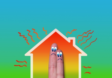 heat loss: house with high heat loss illustration where two fingers inside on green background Stock Photo