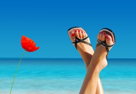 feet crossed: feet crossed on an island paradise Stock Photo