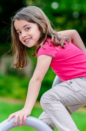pretty little girl: portrait of pretty little girl on a playground Stock Photo