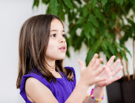 beautiful girl clapping hands Stock Photo