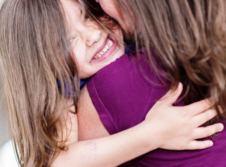 Expressive portrait of pretty girl hugging her mother Stock Photo - 23496747