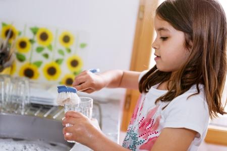 Portrait of lovely girl doing crockery