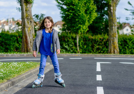 rollerblade: Pretty little girl doing rollerblade in the street
