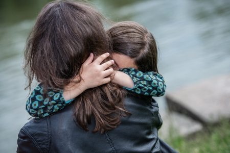 Expressive portrait of pretty girl hugging her mother Stock Photo - 23503671
