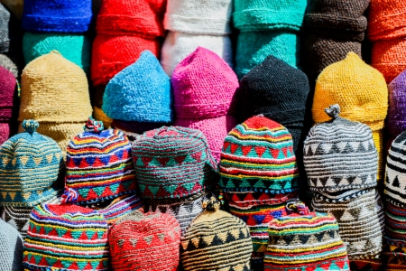 artisanry: colorful wool caps for sale in oriental market