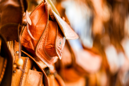 Leather bags on stall on the street market in Morocco