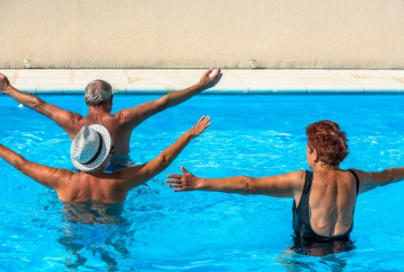 Active seniors getting a workout at the swimming pool Banco de Imagens
