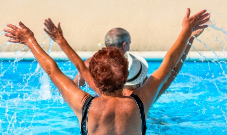 Active seniors getting a workout at the swimming pool Stock Photo