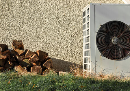 kw: pile of firewood and Airconditioning near a wall