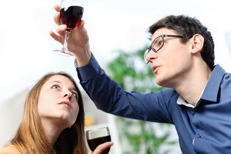 Very beautiful young couple toasting wine glasses Фото со стока