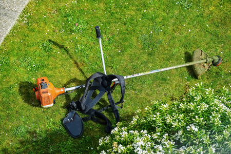 corded: corded string trimmer in a park Stock Photo