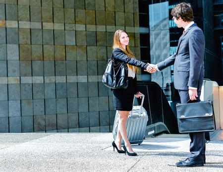 out of business: Junior executives dynamics shaking hands Stock Photo