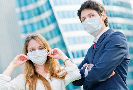 Junior executives dynamics  wearing protective face mask against pollution