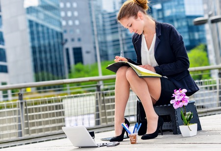 openspace: Junior executive dynamic working outside of her office Stock Photo