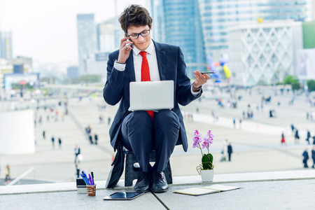 openspace: Junior executive dynamic phoning outside of his office